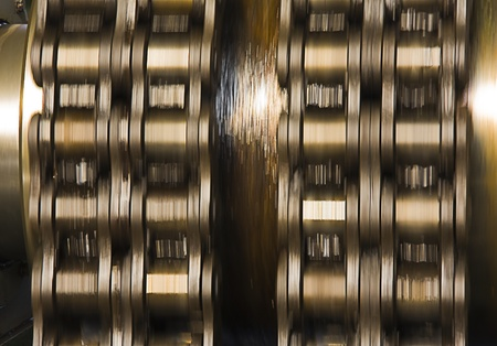 Huge greasy roller chain in motion