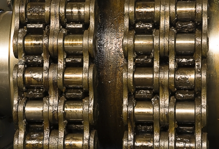 Huge greasy roller chain Stock Photo