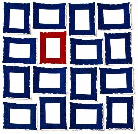 A Red Frame between Many Portrait   Landscape Frames Stock Photo