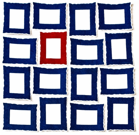 A Red Frame between Many Portrait   Landscape Frames Standard-Bild