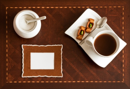 Cup of Coffee and Text Picture Field on a Woodwork Background photo