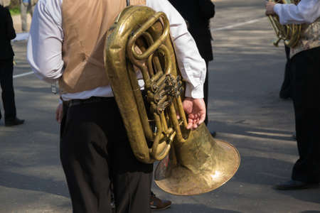 tuba: A musician from a brass band with a tuba