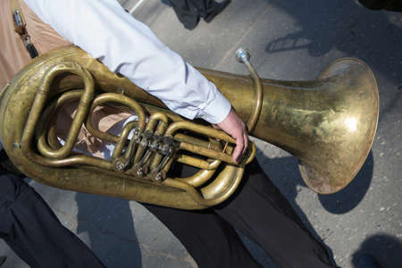brassy: A musician from a brass band with a tuba