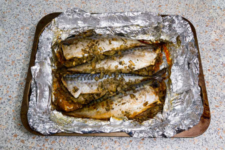 stuffed fish: Fish stuffed with spices, baked in foil on a baking sheet