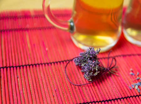 Herbal tea with oregano in glass glasses. A bouquet of dried oregano.