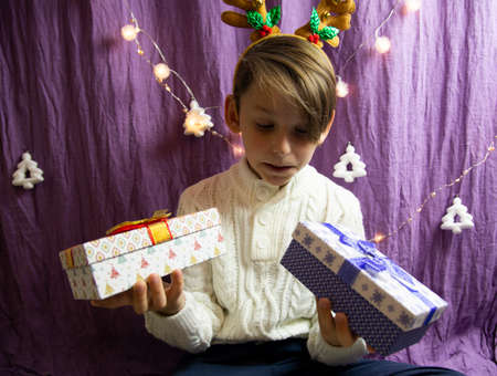 A 10-year-old European boy receives Christmas gifts, his face expresses doubt.