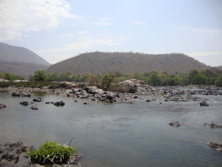 river surrounded by hills to spend time lovely