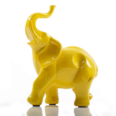Yellow Ceramic Porcelain Elephant on White with Reflection Reklamní fotografie - 91835328