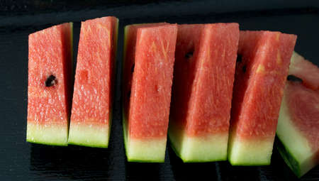 Fresh Fruits, Close Up of Ripe and Sweet Refreshing Watermelon on A Black Plate. photo