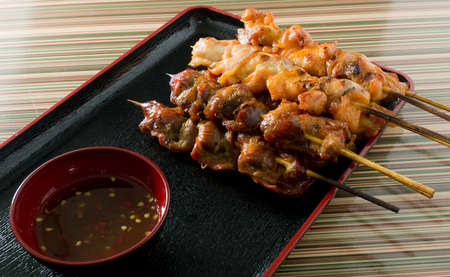 Food and Cuisine, Chicken Grilled or Barbecue Chicken on Bamboo Skewer Served with Spicy Sauce. photo