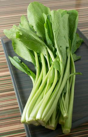 bok choy: Vegetable, Fresh Oganic Chinese Cabbage, Pok Choi, Bok Choy or Pak Choi on Grey Tray. Stock Photo
