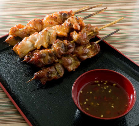 Food and Cuisine, Chicken Grilled or Barbecue Chicken on Wooden Skewer Served with Spicy Sauce. photo