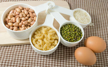 Food Ingredient, Pasta, Rice, Peanuts, Mung Beans and Egg High in Carbohydrate and Protein. Stock Photo