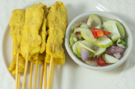 bamboo stick: Food and Cuisine, Grilled Pork Satay on Bamboo Stick Served with Cucumber Salad.