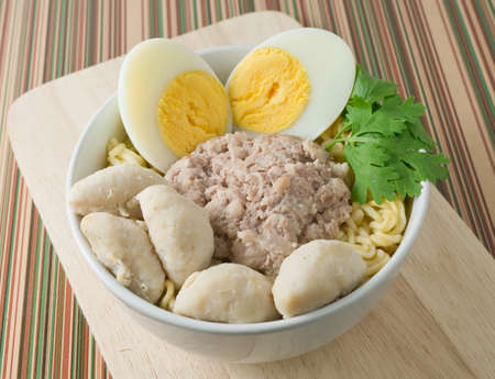 cooked instant noodle: Cuisine and Food, Delicous Asian Ramen Instant Noodles with Pork, Meat Balls and Boiled Egg in A White Bowl.