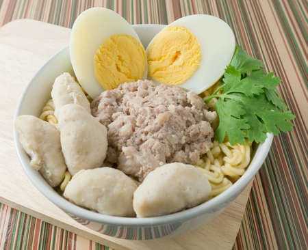cooked instant noodle: Cuisine and Food, Asian Ramen Instant Noodles with Pork, Meat Ball and Boiled Egg in White Bowl.