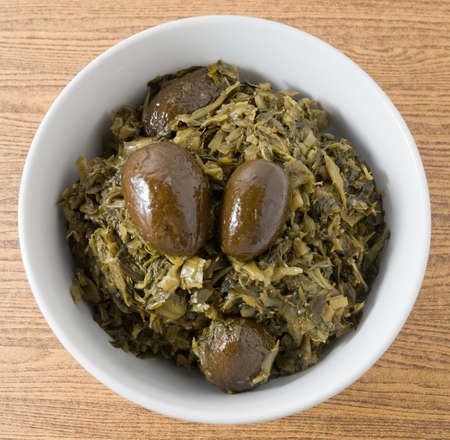 green cabbage: Chinese Traditional Food, Chopped Pickled Green Cabbage with Chinese Olives in A Bowl.