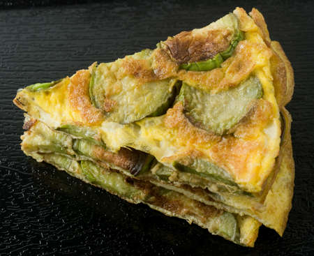 eggplant: Thai Cuisine and Food, Thai Traditional Green Eggplant Omelet Served with Spicy Shrimp Paste Dip on A Black Tray.