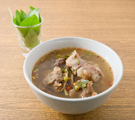 entrails: Thai Cuisine and Food, A Bowl of Delicious Thai Clear Spicy Hot and Sour Soup with Beef Entrails.