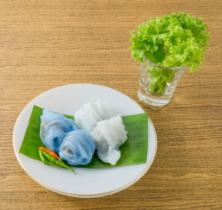 Thai Traditional Dessert, Plate of Steamed Rice Skin Dumplings Made From Glutinous Rice Filled with Minced Pork and Sweet Pickled White Radish.