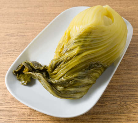 Chinese Traditional Food, Pickled Green Chinese Cabbage on A Dish.