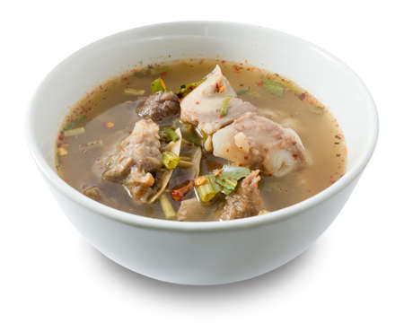 Thai Cuisine and Food, Delicious Thai Clear Spicy Hot and Sour Soup with Beef Entrails Isolated on White Background.