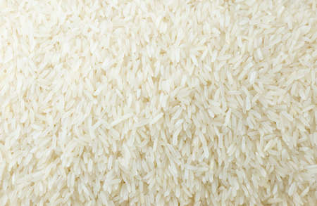 Cuisine and Food, Background of Uncooked White Long Rice, Basmati Rice or Jasmine Rice.