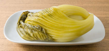 Chinese Traditional Food, Pickled Green Chinese Cabbage on A White Dish.
