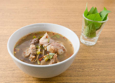 entrails: Thai Cuisine and Food, A Bowl of Thai Clear Spicy Hot and Sour Soup with Beef Entrails.