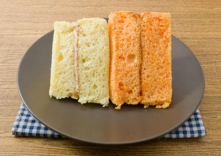 flavorings: Snack and Dessert, Vanilla and Orage Chiffon Cake Made With Butter, Eggs, Sugar, Flour, Baking Powder and Flavorings on A Dish.