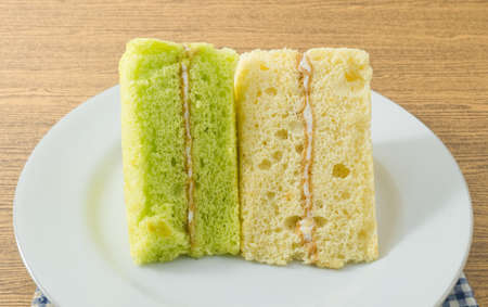 flavorings: Snack and Dessert, Pandan and Vanilla Chiffon Cake Made With Butter, Eggs, Sugar, Flour, Baking Powder and Flavorings on A White Dish. Stock Photo
