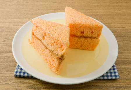 flavorings: Snack and Dessert, Orage Chiffon Cake Made With Butter, Eggs, Sugar, Flour, Baking Powder and Flavorings on A Dish.