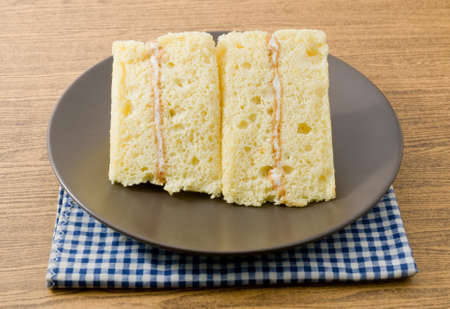 flavorings: Snack and Dessert, Vanilla Chiffon Cake Made With Butter, Eggs, Sugar, Flour, Baking Powder and Flavorings on White Dish. Stock Photo