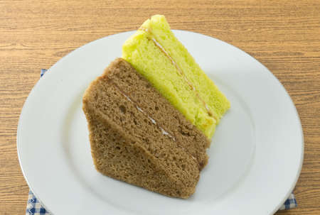 flavorings: Snack and Dessert, Pandan and Coffee Chiffon Cake Made With Butter, Eggs, Sugar, Flour, Baking Powder and Flavorings on A White Dish. Stock Photo