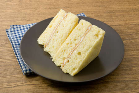 flavorings: Snack and Dessert, Vanilla Chiffon Cake Made With Butter, Eggs, Sugar, Flour, Baking Powder and Flavorings on A Black Dish.