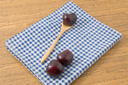very good: Fresh Fruits, Ripe and Sweet Red Plums A Very Good Source of Vitamin C on Blue and White Checked Towel.