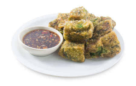 odorum: Chinese Traditional Food, A Plate of Fried Chinese Pancake or Fried Steamed Dumpling Made of Garlic Chives, Rice Flour and Tapioca Flour Served with Spicy Soy Sauce. Stock Photo