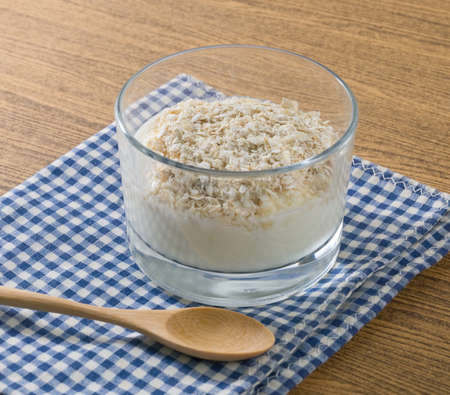 riboflavin: Cup of Homemade Yoghurt Topping with Porridge Oats, Nutritionally Rich in Protein, Calcium, Riboflavin, Vitamin B6 and Vitamin B12.