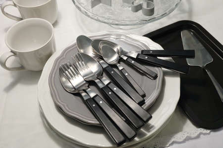 special occasions: Kitchen Utensil, Ceramic Dishes, Plates, Coffee Cup, Silverware, Cake Spatula and Cookie Cutters Preparing for Special Occasions. Stock Photo