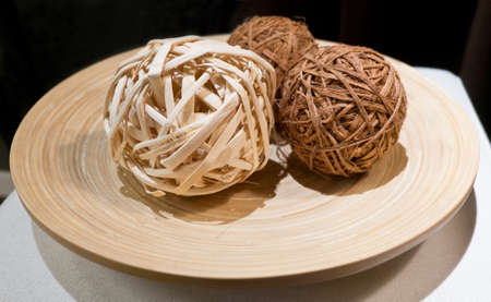 straw twig: Woven Wickers, Bamboo Balls or Rattan Balls on Wooden Tray Used for Decorating.