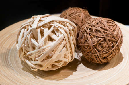 weave ball: Three Woven Wickers, Bamboo Balls or Rattan Balls on Wooden Tray Used for Decorating.