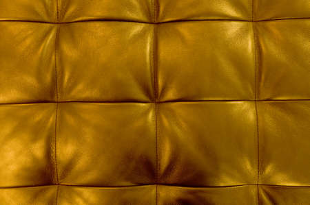 luxuriance: Background Pattern, Closed up of Abstract Texture of Golden Leather Sofa or Upholstery Background.
