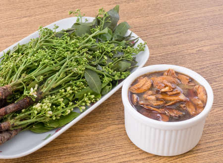 neem: Thai Cuisine and Food, Close Up of Margosa or Neem Leaves and Blossom Served with Sweet Sauce.