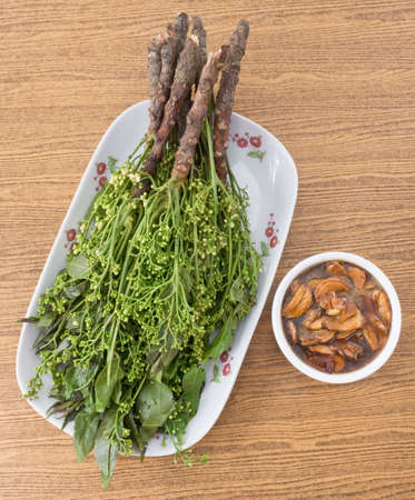 neem: Thai Cuisine and Food, Top View of Boiled Margosa or Neem Leaves and Blossom Served with Sweet Sauce.