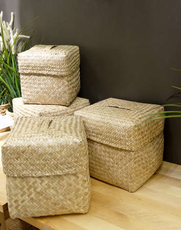 wooden basket: Set of Four Bamboo Wicker Weave Containers Cube for Storage Compartment. Stock Photo