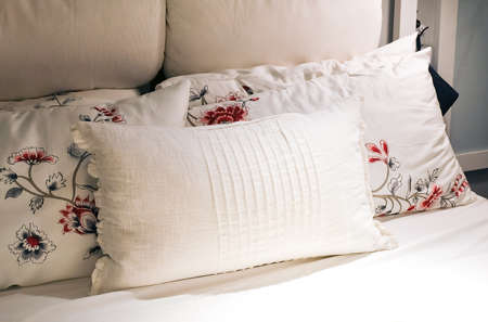 bedder: White Cozy Bed with Comfortable Soft Vintage Pillows In The Morning Light.