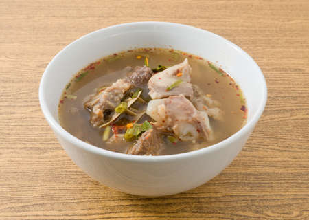 Thai Cuisine and Food, Delicious Thai Clear Spicy Hot and Sour Soup with Beef Entrails in A Bowl. Stock Photo