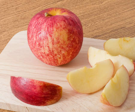 Fresh Fruits, Fresh Ripe and Sweet Red Apple on A Wooden Tray. Stock Photo