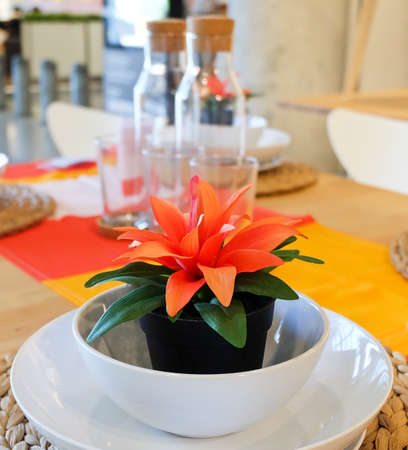Beautiful Artificial Plant with Orange Blossom in Flowerpot for Home and Building Decoration. Stock Photo
