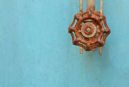 Rusted Valve and Pipe with Old Glass Tube on The Blue Metal Grunge Boiler Machine. Stock Photo